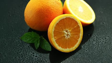 Orange-with-leaf-on-wet-table