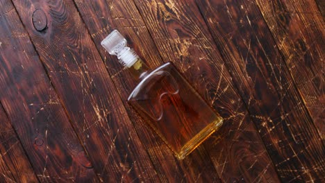 Bottle-of-whiskey-on-wooden-table