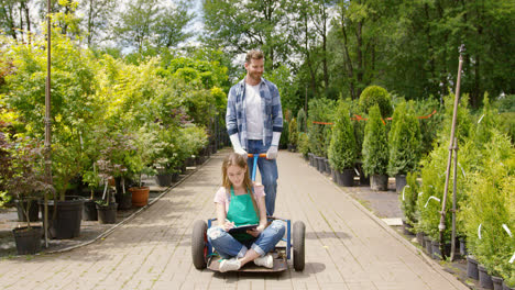 Woman-gardner-sitting-on-wagon-in-garden-and-doing-paperwork