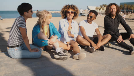 Happy-young-friends-on-city-seashore-