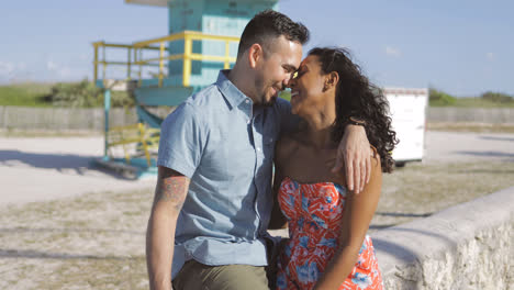 Happy-multiracial-couple-on-seafront