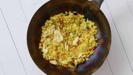 Delicious-Thai-dish-in-hot-Wok-Fried-chicken-with-rice-and-vegetables-Spin-360-Slow-motion