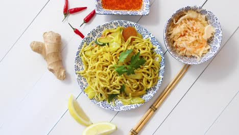 Tasty-and-Fresh-Noodles-with-Chicken-and-vegetables-served-on-ceramic-plate-with-chopsticks