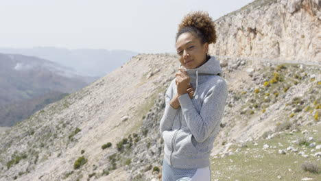 Young-smiling-sporty-woman-posing-on-nature