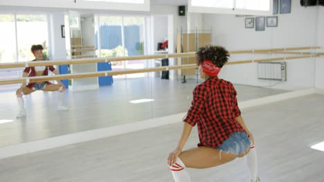Female-dancer-practices-her-moves-in-studio
