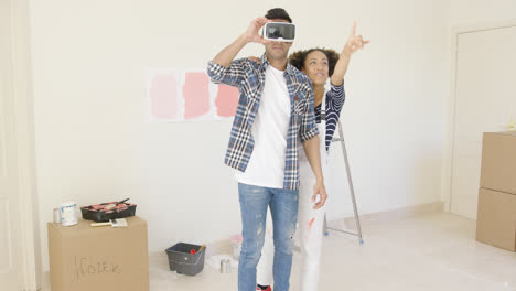 Man-using-virtual-reality-glasses-gets-help