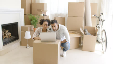 Young-black-couple-moving-into-their-new-home