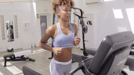 Confident-woman-training-in-gym