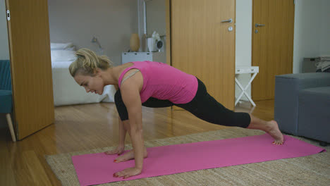 Young-woman-performing-lunges
