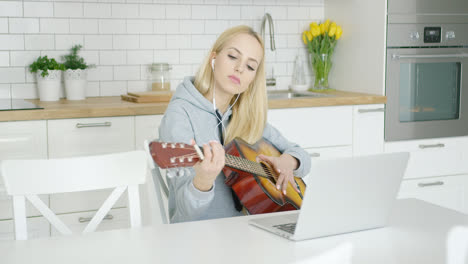 Female-guitarist-practicing-at-home