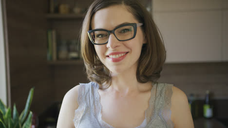 Smiling-beautiful-woman-in-eyeglasses-at-home