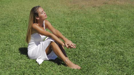 Sensual-girl-relaxing-on-lawn