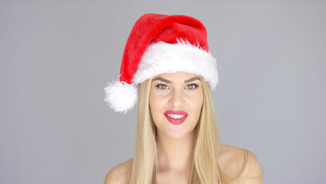 Adorable-beautiful-girl-posing-isolated-in-Santa-Claus-Hat
