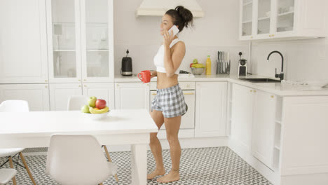 Side-view-of-woman-talking-phone-