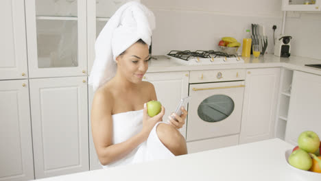 Woman-after-shower-with-phone-and-apple