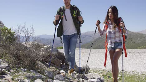 Two-young-people-trekking-in-mountains