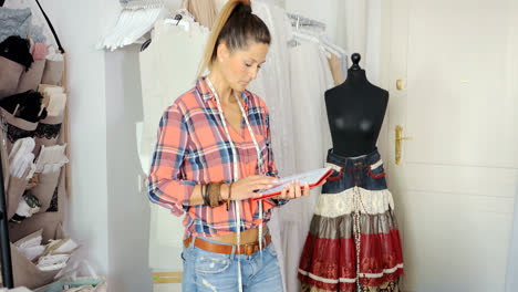 Woman-with-tablet-in-tailor's-shop