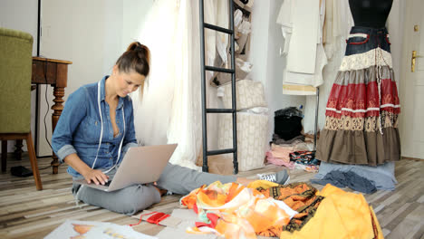 Woman-with-laptop-in-tailor-s-shop
