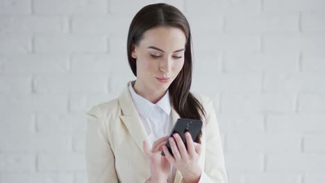 Beautiful-elegant-business-woman-browsing-her-smartphone