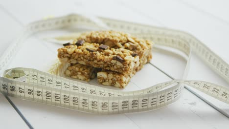 Granola-bars-with-dried-fruits-wooden-background