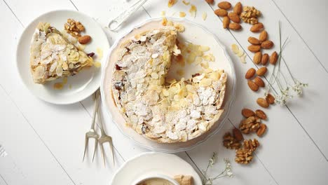 Fresh-baked-tasty-homemade-apple-pie-cake-with-ingredients-on-side