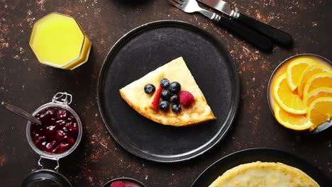 Tasety-homemade-pancake-on-black-ceramic-plate-
