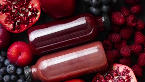 Mix-of-fresh-red-and-black-fruits-With-botteled-fresh-juices