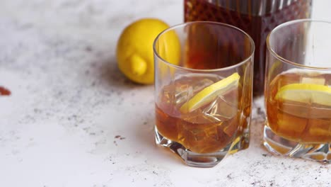 Whiskey-sour-drink-with-lemon-in-glass-on-stone-rustical-background