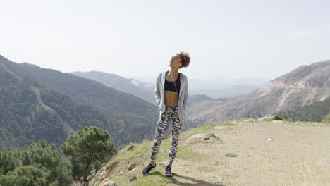 Delightful-young-sportswoman-in-mountains
