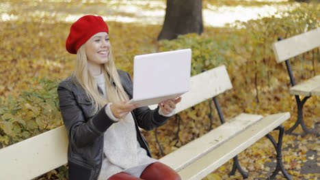 Woman-using-video-chat-app-on-laptop