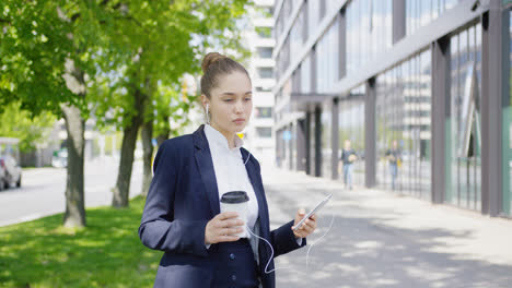 Pretty-formal-woman-with-coffee-and-smartphone
