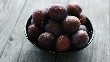 Washed-whole-plumbs-in-bowl-