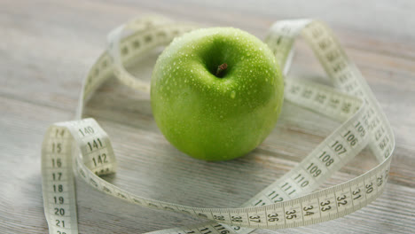 Green-apple-and-tape-measure-