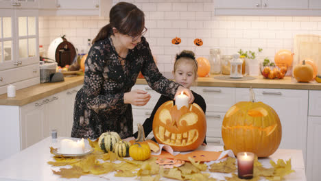 Woman-putting-candle-into-jack-o-lantern