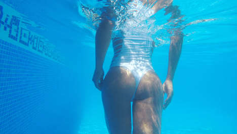 Crop-sexy-woman-underwater
