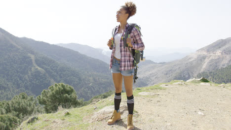 Happy-young-woman-on-top-of-mountains