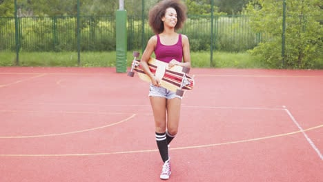 Sporty-woman-with-longboard