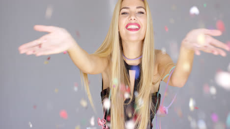 Sexy--blond-girl-blowing-confetti-to-camera-direction