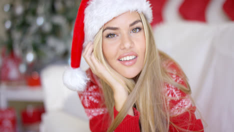 Beautiful-girl-in-Santa-Claus-hat-in-her-living-room
