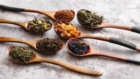 Spoons-with-different-types-of-dry-tea-leaves-