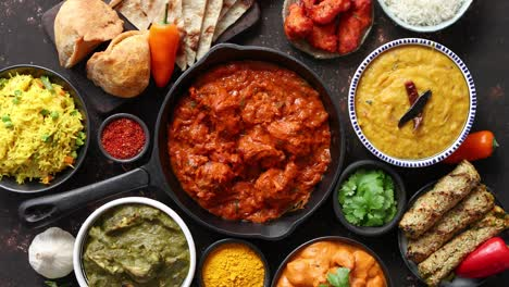 Various-Indian-dishes-on-a-table-Spicy-chicken-Tikka-Masala-in-iron-pan
