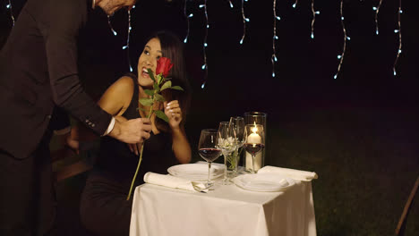Romantic-man-surprising-his-date-with-a-rose