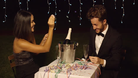 Couple-celebrates-with-champagne-in-bucket