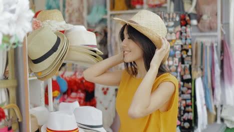 Charming-model-trying-on-hats-in-shop