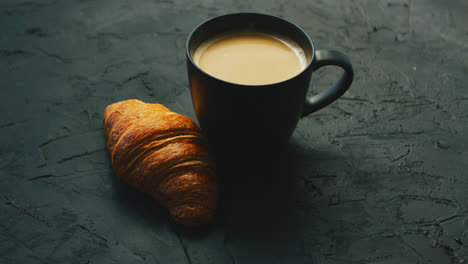 Cup-of-coffee-and-croissant