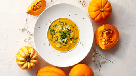 Pumpkin-soup-in-plate-with-vegetables-around