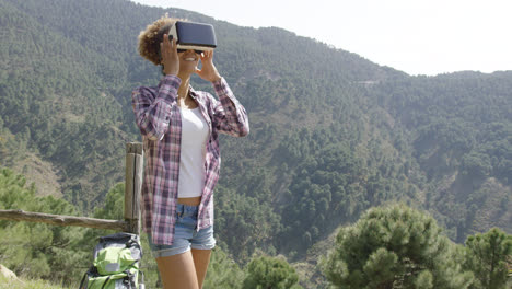 Female-backpacker-in-VR-glasses