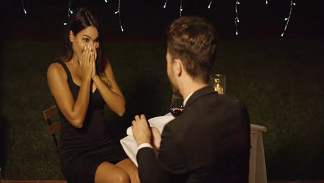 Young-man-proposing-to-a-gorgeous-young-woman