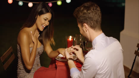 Romantic-young-man-proposing-to-his-love
