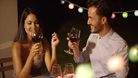 Romantic-young-couple-enjoying-dinner-and-wine